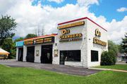 OIL CHANGERS: Get premier emission testing and tire rotation services